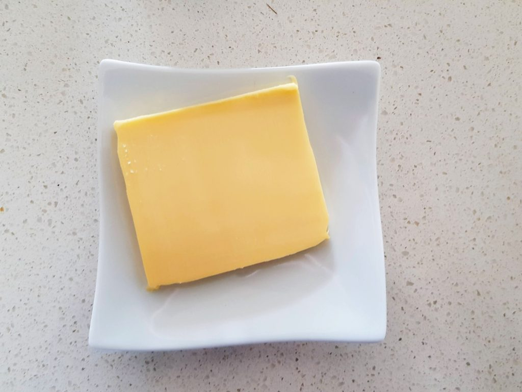 Slice of butter on plate