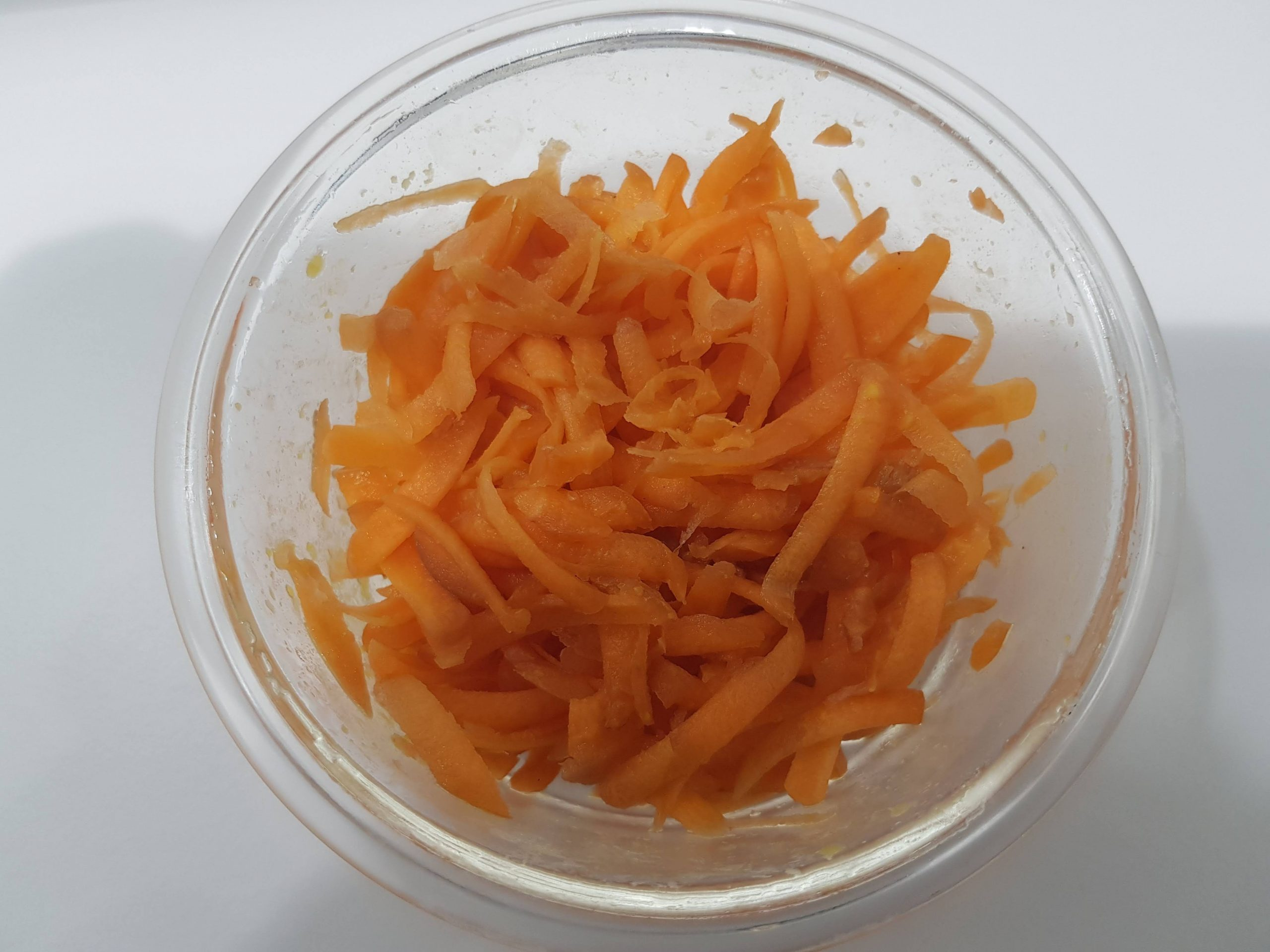 grated carrot in a glass bowl